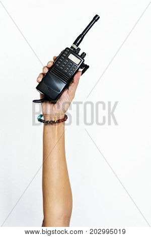 Hand holding portable two way radio isolated on white