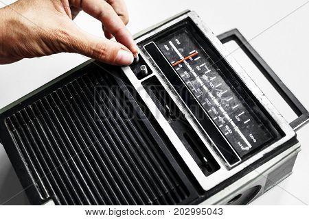 Closeup of hand tuning classic retro radio transistor