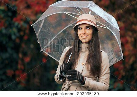 Happy Woman with Clear Plastic Transparent Umbrella in Autumn Rain