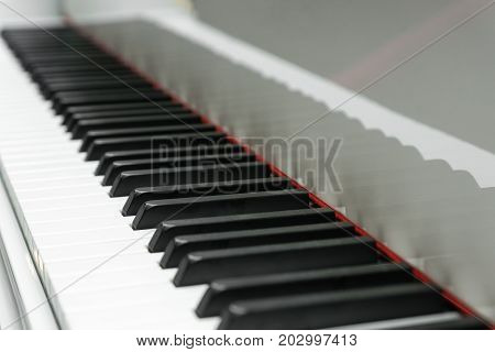 Piano keyboard background with selected focus - narrow depth of field.