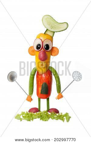 Vegetable chief with spoons on isolated background