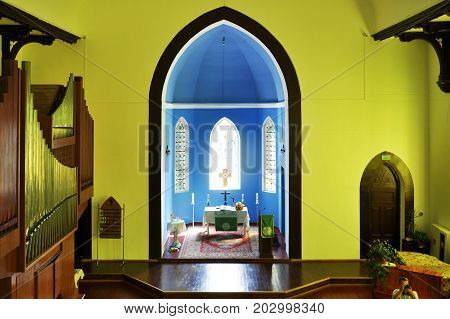 Grodno, Belarus - July 30, 2017: Interior of the Lutheran Church in yellow light. View of the altar.