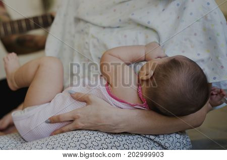 Mother Suckling Feeding Her Baby Newborn