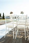 White Chiavari chairs for wedding guests at the ceremony poster