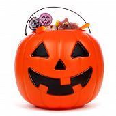 Halloween Jack o Lantern candy collector filled with candy over a white background poster
