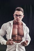 Dorky man with eyeglasses and muscle chest with ripped pecs showing under open shirt poster