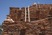 Southwestern Hopi House 1905 Architecture Abstract with Wooden Ladders and Clear Blue Sky. poster