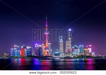 Cityscape Of Shanghai At Twilight Sunset. Panoramic View Of Pudong Business District Skyline From Th