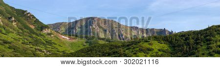 Mountain Ridge With Rocky Outcrops. Panoramic View From Slope Partly Covered With Dwarf Mountain Pin