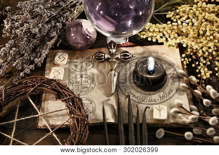 Old Witch Diary Book With Cross, Pentagram And Black Candle On The Table. Wicca, Esoteric, Divinatio