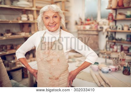 Joyful Grey Haired Woman Smiling To You