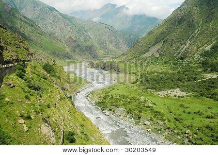 Georgian Military Highway, Caucasus mountains, border between Georgia and Russia poster