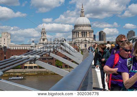 St Pauls  London  United Kingdom  -12 May 2019: Tourists Crossing Millenium Bridge With St Pauls Cat