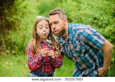 Biggest Pollen Allergy Questions. Father Little Girl Enjoy Summertime. Dad And Daughter Blowing Dand