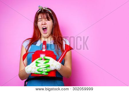 Photo of tired florist woman with watering can in hand