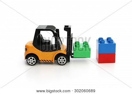 Kids Toys. Yellow Forklift Toy Ships Color Cubes. Toys For Children. Small Loader And Three Dice.