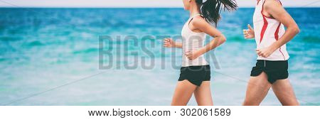 Sports athletes runners couple training together jogging on blue ocean background panoramic banner with copyspace. Two joggers exercising, woman and man. poster