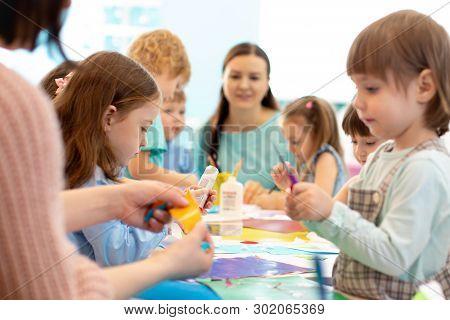 Development Learning Children In Preschool. Childrens Project In Kindergarten. Group Of Kids And Tea