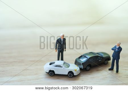 Miniature People : Two Drivers Man Arguing After A Car Traffic Accident Collision. Traffic Accident
