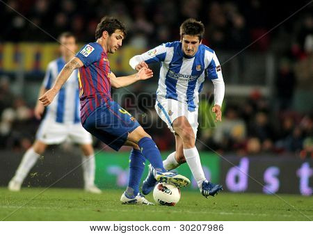 BARCELONA - FEB 4: Cesc Fabregas (L) of Real Sociedad vies with Markel Bergara(R) of Real Sociedad during the Spanish league match at the Camp Nou stadium on February 4, 2012 in Barcelona, Spain