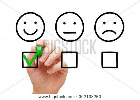 Happy Customer Evaluating With Green Marker Check Mark On Feedback Survey. Client Satisfaction Busin