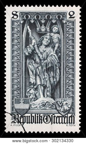 AUSTRIA - CIRCA 1969: A stamp printed in the Austrian, is dedicated to 500th anniversary of Diocese of Vienna, shows the statue of Saint Christopher in St. Stephens Cathedral, Vienna, circa 1969.