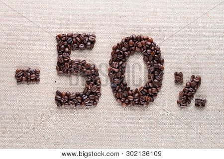 50% Discount From Coffee Beans Aligned In Center, Shot Close Up