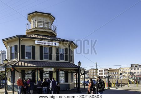 New Orleans, Usa - Dec 11, 2017: The Steamboat Natchez Ticket Booth And Building Bear The French Qua