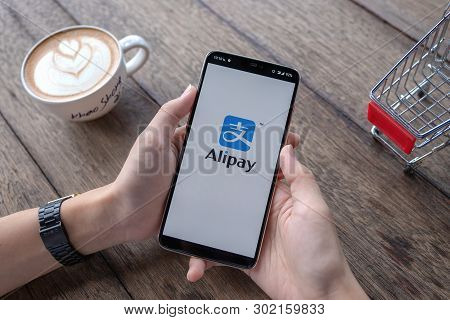 Chiang Mai, Thailand - May 11, 2019 : Male Holding Oneplus 6 With Alipay Logo, Alipay Is Application