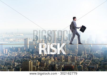 Businessman in risk concept walking on tight rope