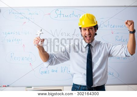 Young male architect in front of the whiteboard