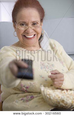Elderly woman watching television