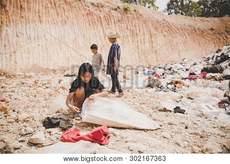 Poor Child In The Landfill Looks Forward With Hope