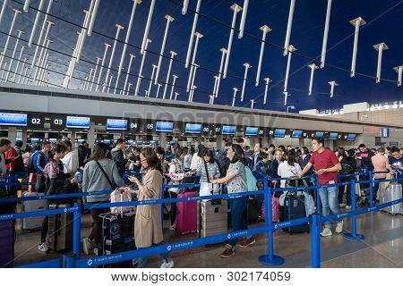 Shanghai, China - March 2019: Crowded Check-in Counter Of China Eastern Airlines In Shanghai Pudong