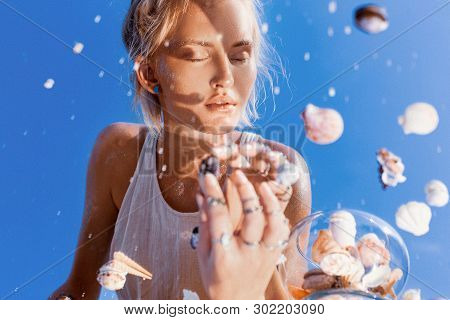 Beautiful Young Woman Model Reflection In Mirror Portrait With Sea Shells