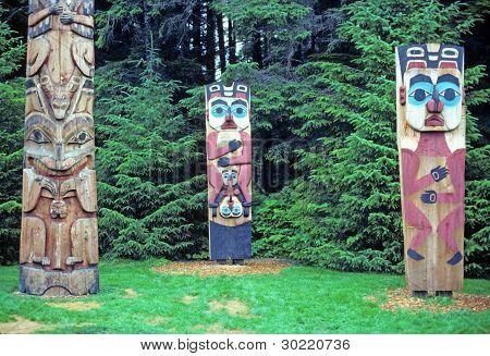 Totem poles in a historical park in Sitka Alaska poster