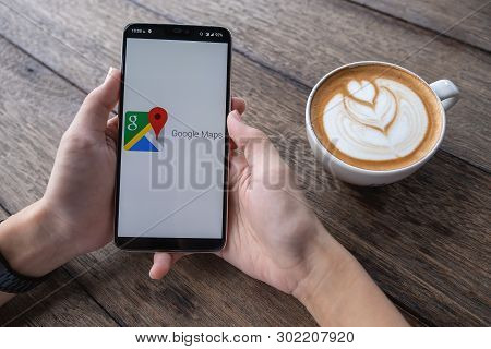 Chiangmai, Thailand - May 11, 2019: Man Hand Holding Oneplus 6 With Google Maps Application O. Googl