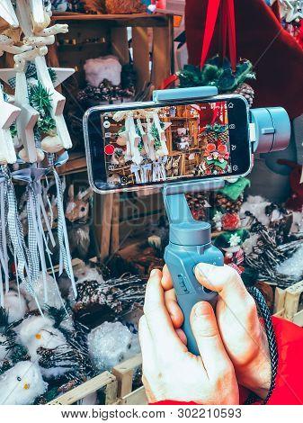 Germany, Nuremberg - December 17, 2018: Close-up Of Man Blogger Hands Shooting Video On Smartphone I