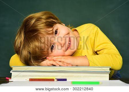Great Study Achievement. Funny Little Boy Pointing Up On Blackboard. Happy School Kids. School Kids.