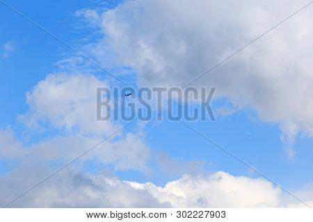 Cumulus Clouds And Aircraft