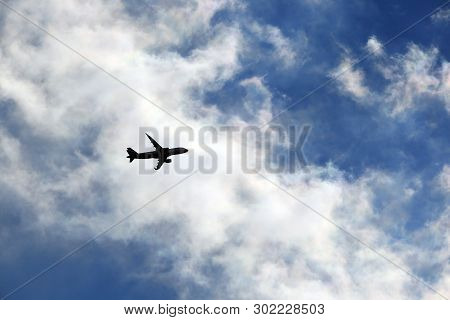 Plane Among The Clouds