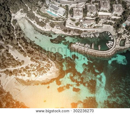 Beautiful birdeye view on the sea coastline with pier and yakhts at sunny day. Travell, jorney,islands, Seascape, freedom, holidays concept.