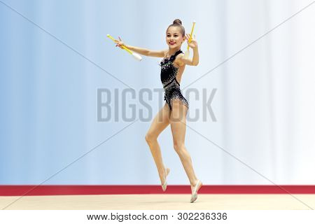 Little talented gymnast girl performs in a rhythmic gymnastics competition, active healthy childhood, beautiful sport poster