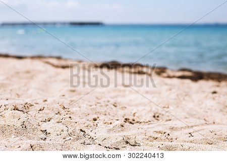 Tropical Beach Background. Blur Bokeh Light Of Calm Sea And Sky. Summer Vacation Background Concept.
