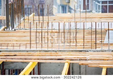 Wooden Frames And Metal Reinforcement At New Building Construction Site