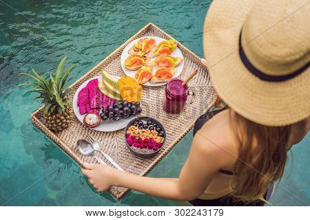 Breakfast Tray In Swimming Pool, Floating Breakfast In Luxury Hotel. Girl Relaxing In The Pool Drink