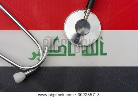 Iraq Flag And Stethoscope. The Concept Of Medicine. Stethoscope On The Flag In The Background.