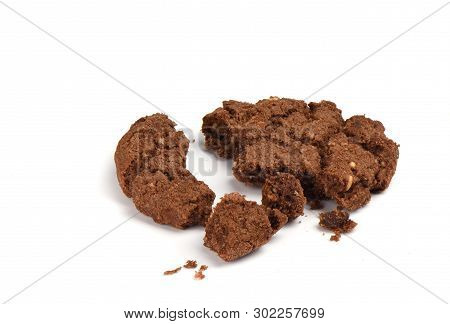 Crumbled Granola Cookies With Chocolate And Hazelnuts Isolated On White Background. Close Up