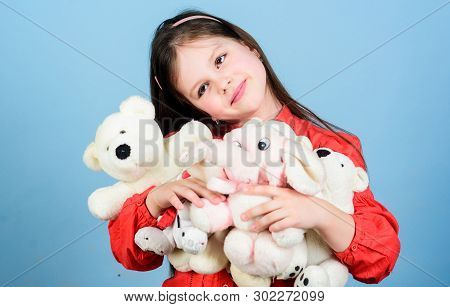Little girl play with soft toy teddy bear. Sweet childhood. Collecting toys hobby. Cherishing memories of childhood. Childhood concept. Small girl smiling face with favorite toys. Happy childhood poster