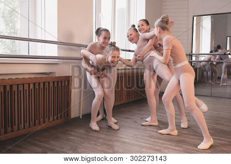 Young Graceful Female Ballet Dancers Dancing At Training Studio. Beauty Of Classic Ballet. Girls Res
